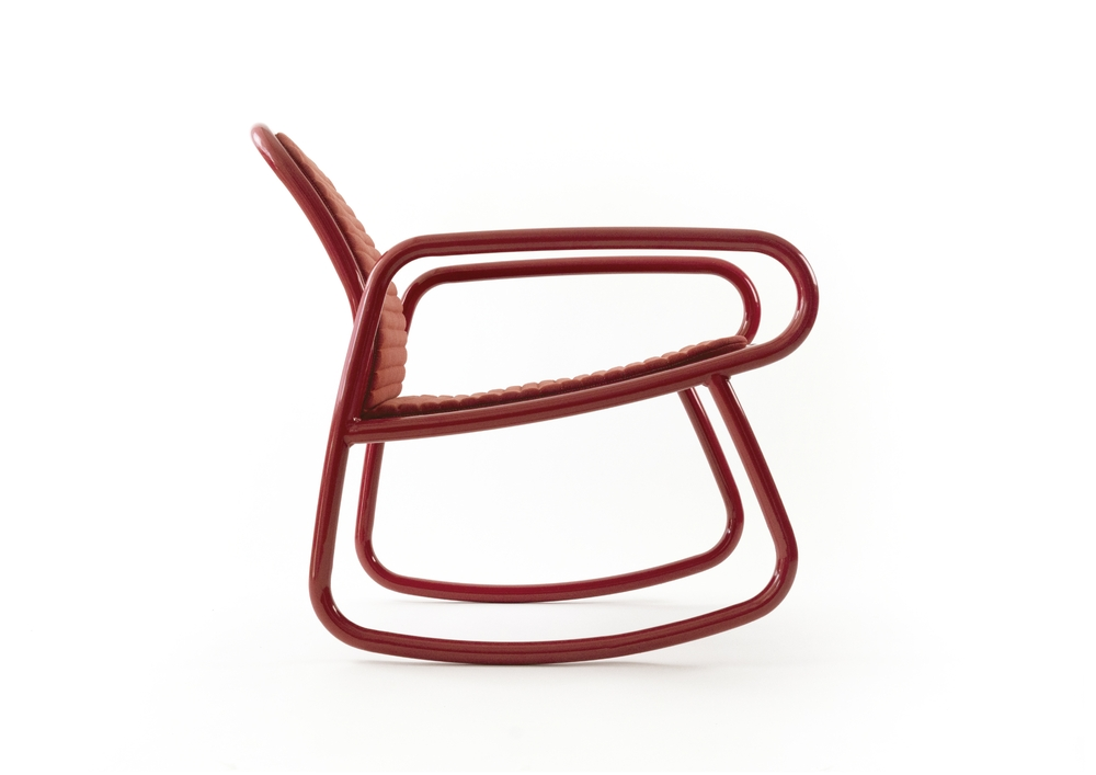 a red minimalistic rocking chair